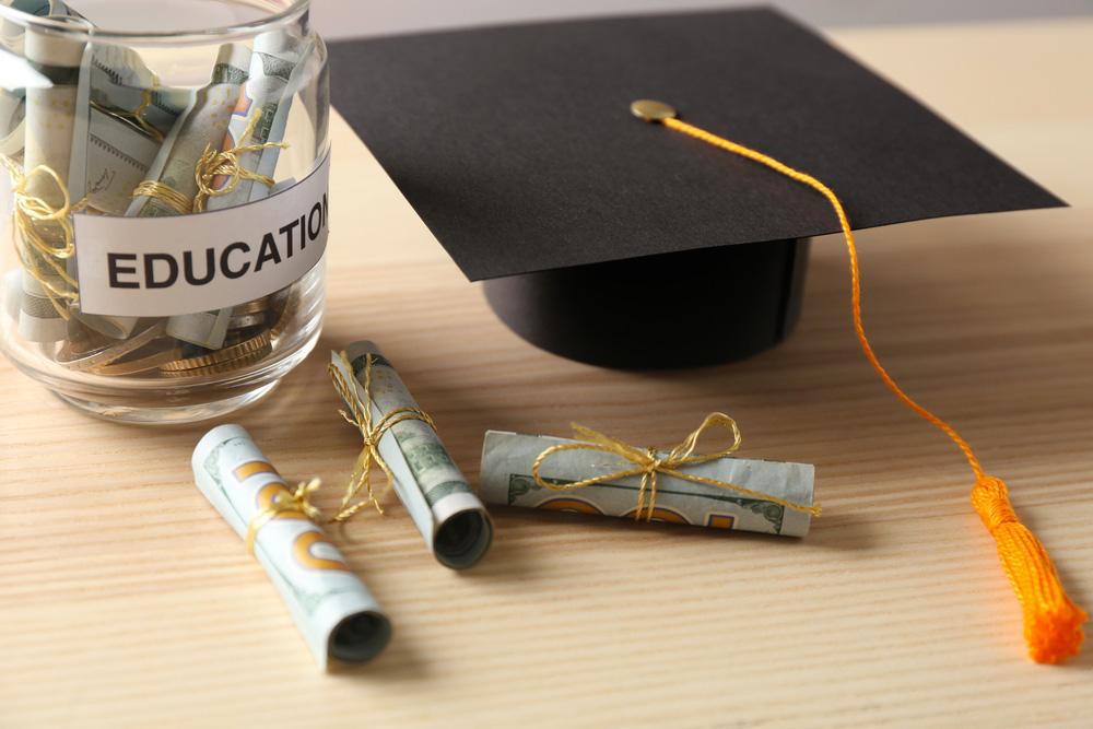 Consider-long-term-financial-plans-money-in-jar-mindandmom